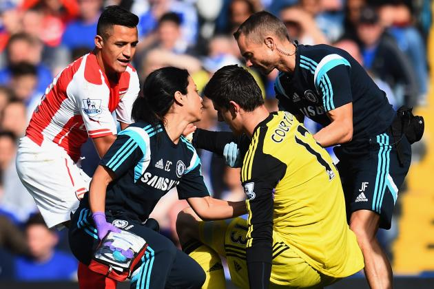 Chelsea's Thibaut Courtois is revived after suffering a concussion following a clash with Arsenal player Alexis Sanchez